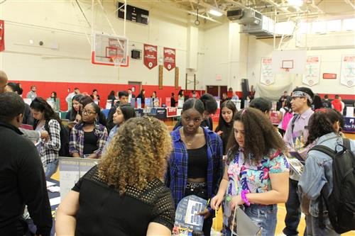Students at college fair in gym