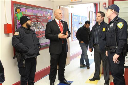 Superintendent Dr. Baiocco speaks with members of the EPD.
